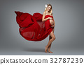 Pregnant girl in red dress 32787239