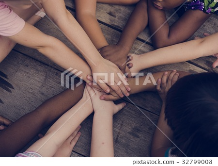 Diverse hands are join together on the wooden table 32799008
