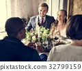 Bride and Groom Having Meal with Friends at Wedding Reception 32799159
