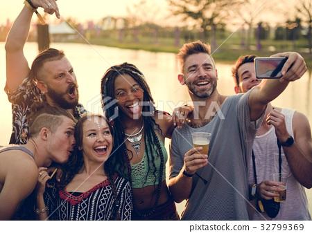 Group of Diverse Friends Enjoying Taking Selfie Photo at Live Mu 32799369