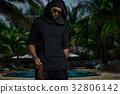 Freak in black costume 32806142