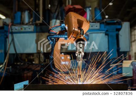 Industrial robot is welding part in factory 32807836