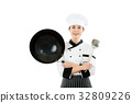 female chef showing wok and spatula tools 32809226