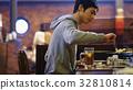 Men tasting Genghis Khan 32810814
