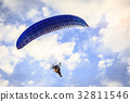 Paraglider flying in the blue sunny sky 32811546