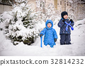 kids and a lot of snow. playing outdoors in winter 32814232