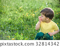Little caucasian boy allergies from yellow flower 32814342