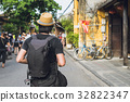 Young asian traveler with backpack at Hoi An 32822347
