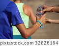 Drinks station at a trail running marathon 32826194