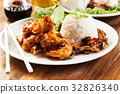 Fried chicken pieces with sweet and sour sauce 32826340