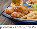 Fish and chips with tartar sauce on a plate 32826352