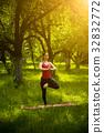Woman practicing yoga balance asana. 32832772