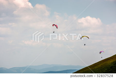 Skydiving extreme over the mountains 32837528