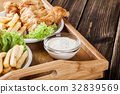 Fish and chips with tartar sauce on a tray 32839569