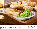 Fish and chips with tartar sauce on a tray 32839570