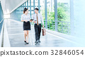 Asian Business people walking and talking   32846054