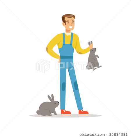 Farmer woman caring for rabbits, farming and 32854351