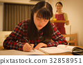 Girl and mother to study for exam 32858951