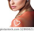 Sunblock on the female shoulder. 32860621
