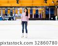 Woman on skating rink 32860780
