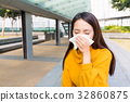 Asian woman runny nose 32860875