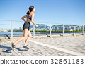 Young woman running in a city 32861183