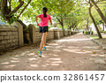 Rear view of woman running in a park 32861457