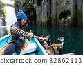 Woman feeding duck and travel on boat in Takachiho gorge 32862113
