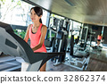 Young Woman training on treadmill in gym 32862374