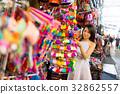 Young woman shopping at street market 32862557