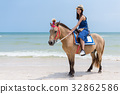 Beautiful Woman riding horse in sand beach 32862586