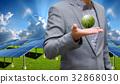 Businessman carry world of wind turbine 32868030