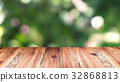 Perspective wood and bokeh light background 32868813