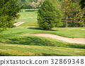 Sand bunkers on the golf course hill 32869348