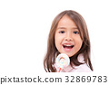 playful cute little girl with sweet marshmallow 32869783