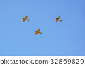 three vintage airplane in flight . at empty blue 32869829
