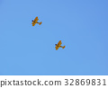 two vintage airplane in flight . at empty blue sky 32869831