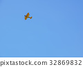vintage airplane in flight . at empty blue sky 32869832