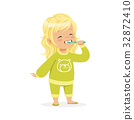 Beautiful cartoon blonde girl in a green pajamas 32872410