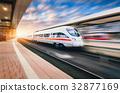 White modern high speed train in motion 32877169
