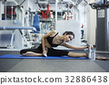 A portrait of a girl doing yoga exercise at a fitness room 32886438