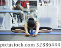 A woman is stretching at a sport club 32886444