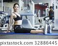 A woman in sportswear is doing yoga 32886445