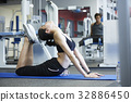 A girl is doing yoga exercise at a room 32886450