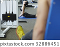 A picture of a girl stretching at a fitness centre 32886451