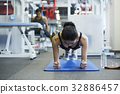 A young woman is practising hardly at a fitness room 32886457