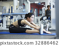 A girl is practising a yoga exercise at a sport club 32886462