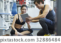 A coach is training for a girl with a tablet 32886484