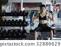 young woman is doing fitness exercise with two dumbbells 32886629