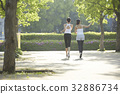 The picture of two women doing exercise outdoors together 32886734